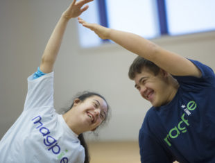 a male and a female learning disabled dancer pose for the camera