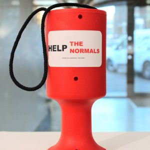 Red collecting can with the slogan 'help the normals' written across it.