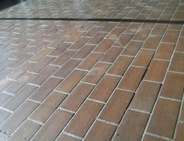 colour photograph of a tiled floor holding dust