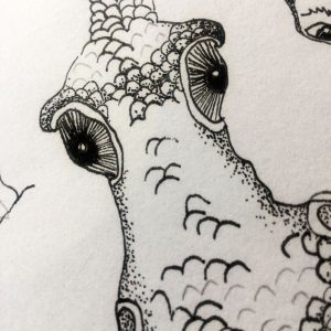 doodle with the face of a creature drawn with simple line and shading