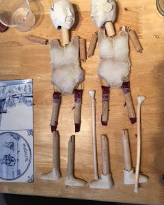 two puppet bodies lying side by side