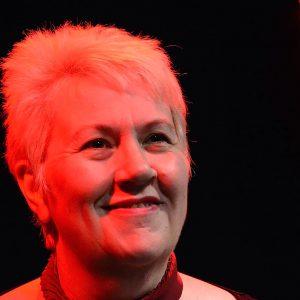 Head shot of Vici Wreford-Sinnott under a red light