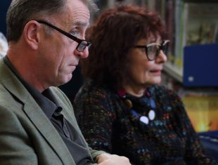 John O'Donoghue and Lynne E. Blackwood in the audience listening to a spoken word performance