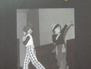 Book cover showing two children performing on stage, with the author's name and book title above