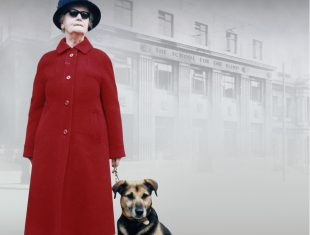Woman with a red coat and a dog