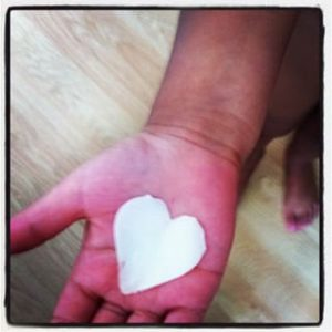 Hand with paper heart - by Gemma Nash