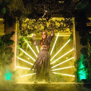 Woman dancing in front of neon lights