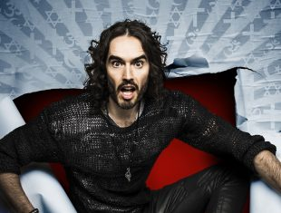 Russel brand jumping through wallpaper