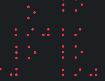 Black book cover with red braille dots