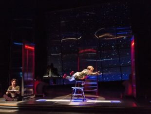 Photo of the actor Mickey Rowe flying across a stage