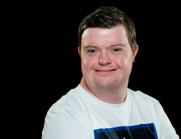 Portrait shot of smiling Coronation Street actor Liam Bairstow