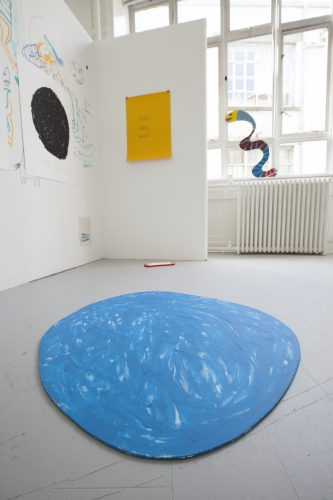 Installation shot showing big blue circle on the floor