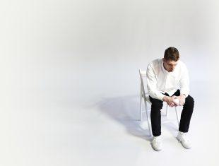 Dan Daw sitting on a chair