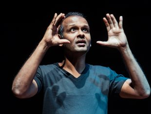 Photograph of Ramesh Meyyappan his hands either side of his face
