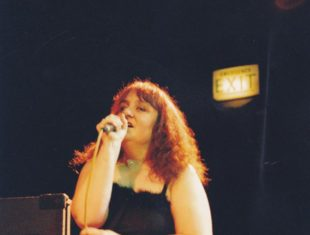 Woman behind mic