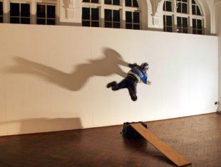 Man jump against a wall