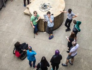 Group of people standing in a circle