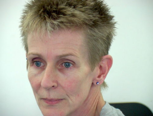 Headshot of a woman with short spiky hair