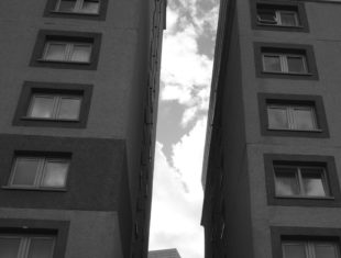 black and white photo of two tower blocks